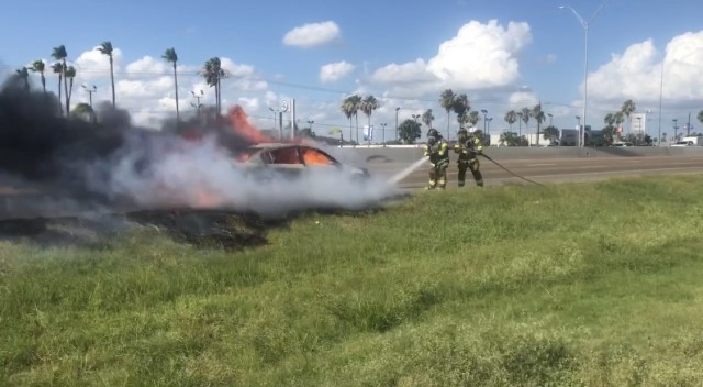 Fire Fighters extinguish vehicle fire