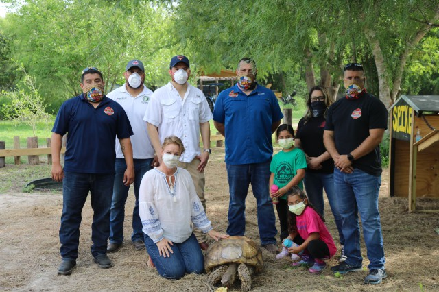 Tortoise receives new home after blaze, fire fighters prepare to paint new home as fire station.